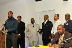 "Eric Strong and the ""See A Man, Be A Man"" Program developers receiving the Champion Award for 'Outstanding commitment to community and justice' at the ""Bring A Brother To Breakfast"" Ceremony, presented by the Black Women For Wellness organization."